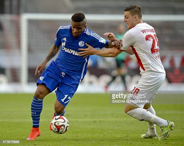 Cologne's Austrian defender Kevin Wimmer vie for the ball with Schalke's Peruvian striker Jefferson Farfan during the German first division...