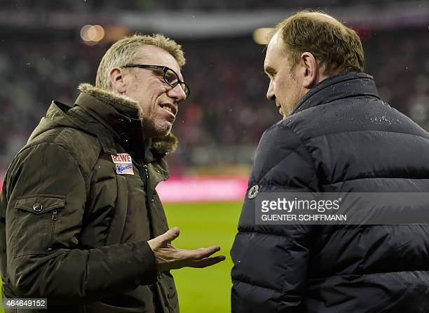 Cologne's Austrian head coach Peter Stoeger talks to Cologne's executive director Joerg Schmadtke ahead of the German first division Bundesliga...