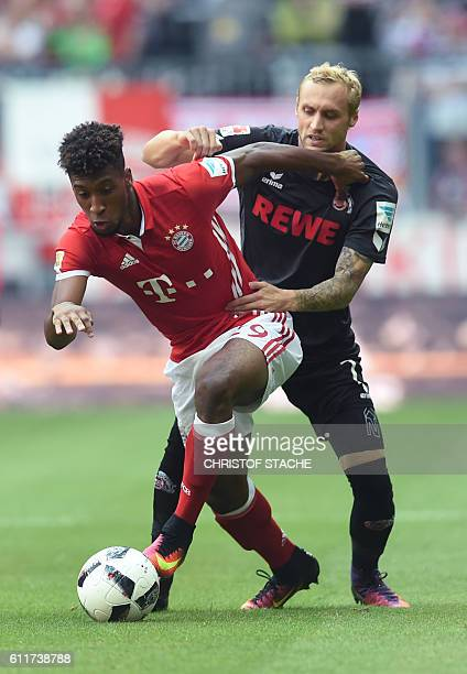 Cologne's Danish defender Frederik Sorensen and Bayern Munich's French midfielder Kingsley Coman vie for the ball during the German first division...