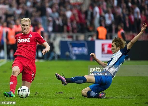 Cologne's Danish defender Frederik Sorensen and Hertha Berlin's Japanese midfielder Genki Haraguchivie vie for the ball during the German first...