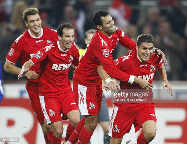 DFL Cologne's defender Youssef Mohamad from Lebanon is congratulated on scoring by his teammates defender Kevin Pezzoni midfielder Petit from...