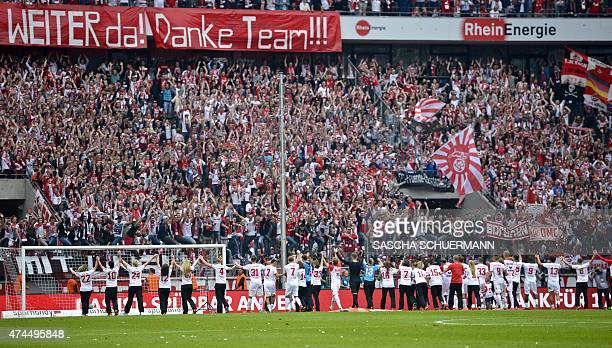 Cologne's fans cheer for their team after German first division Bundesliga football match 1 FC Cologne vs VfL Wolfsburg at the RheinEnergieStadion in...