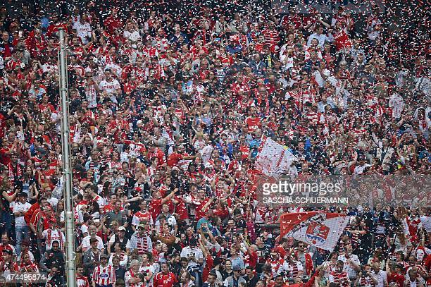 Cologne's fans cheer for their team after the German first division Bundesliga football match 1 FC Cologne vs VfL Wolfsburg at the...