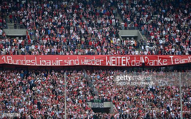 Cologne's fans cheer for their team after the German first division Bundesliga football match between 1 FC Cologne and VfL Wolfsburg at the...