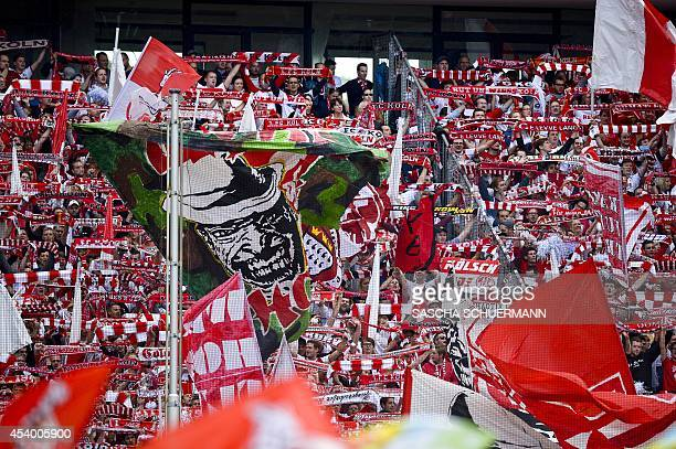 Cologne's fans cheer their team during the German first division Bundesliga football match 1 FC Koeln v Hamburger SV at Rhein Energie stadium in...
