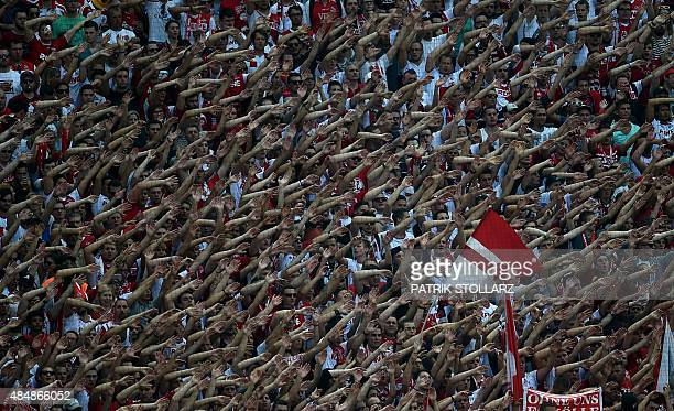 Cologne's fans cheer their team during the German first division Bundesliga football match FC Koeln vs VfL Wolfsburg on August 22 2015 in Cologne...
