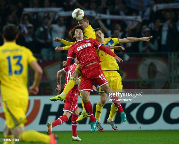 FC Cologne's forward from Japan Yuya Osako and BATE Borisov's defender from Belarus Vitali Gayduchik vie for the ball during the UEFA Europa League...