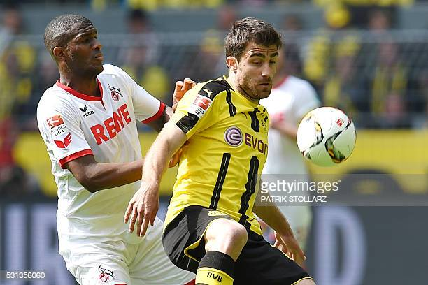 Cologne's French forward Anthony Modeste and Dortmund's Greek defender Sokratis vie for the ball during the German first division Bundesliga football...