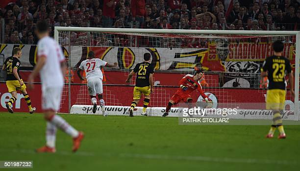 Cologne's French forward Anthony Modeste scores during the German first division Bundesliga football match 1 FC Cologne vs Borussia Dortmund in...