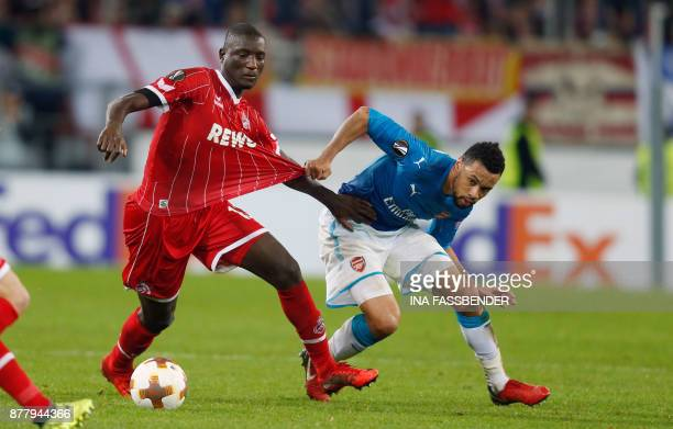 Cologne's French forward Sehrou Guirassy and Arsenal's French midfielder Francis Coquelin vie for the ball during the UEFA Europa League football...