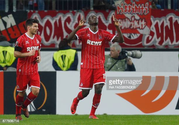 Cologne's French forward Sehrou Guirassy celebrates scoring a penalty with his teammate Serbian midfielder Milos Jojic during the UEFA Europa League...