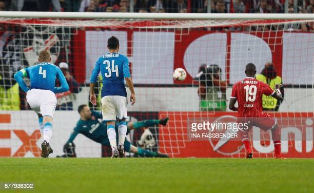 Cologne's French forward Sehrou Guirassy scores a penalty during the UEFA Europa League football match 1 FC Cologne v Arsenal FC on November 23 2017...