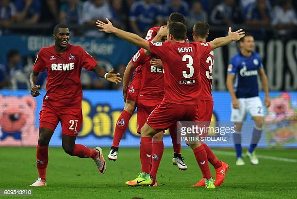 Cologne's French striker Anthony Modeste and his teammates celebrate after he scored during the German first division Bundesliga football match...
