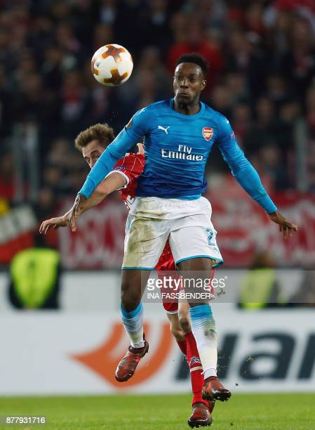 Cologne's German defender Lukas Kluenter and Arsenal's English striker Danny Welbeck vie for the ball during the UEFA Europa League football match 1...