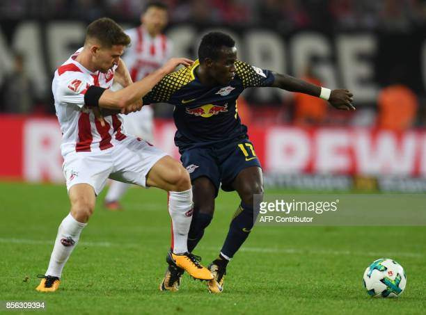 Cologne's German midfielder Salih Ozcan and Leipzig´s Belgian midfielder Massimo Bruno vie for the ball during the German First division Bundesliga...