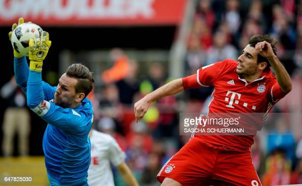 Cologne's goalkeeper Thomas Kessler and Bayern Munich's Spanish midfielder Javier Martinez vie for the ball during the German First division...