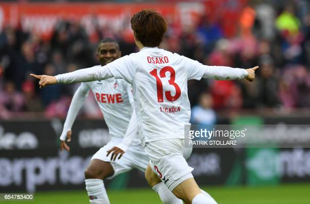 Cologne's Japanese striker Yuya Osako and Cologne's French forward Anthony Modeste celebrate after scoring during the German First division...
