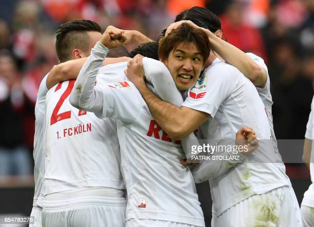 Cologne's Japanese striker Yuya Osako and his teammates celebrate after scoring during the German First division Bundesliga football match of FC...