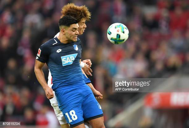 Cologne's Japanese striker Yuya Osako and Hoffenheim's midfielder Nadiem Amiri vie for the ball during the German First division Bundesliga football...