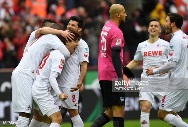 Cologne's Japanese striker Yuya Osako and teammates celebrate after scoring during the German First division Bundesliga football match of FC Cologne...