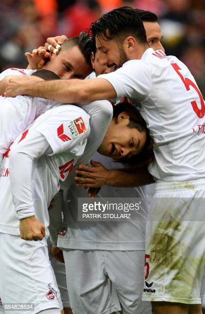 Cologne's Japanese striker Yuya Osako celebrates during the German first division Bundesliga football match of 1FC Cologne vs Hertha BSC Berlin in...