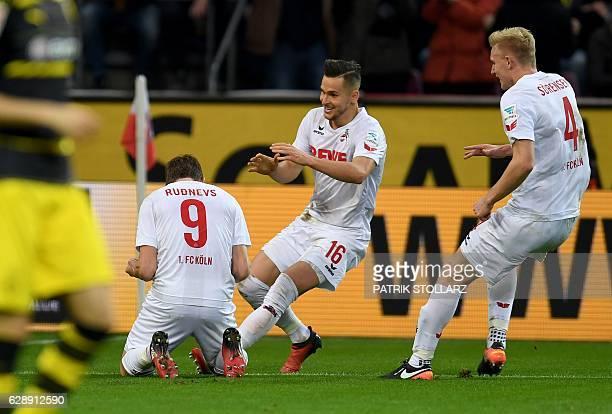 Cologne's Latvian striker Artjoms Rudnevs celebrates scoring during the German first division Bundesliga football match between 1 FC Cologne and...