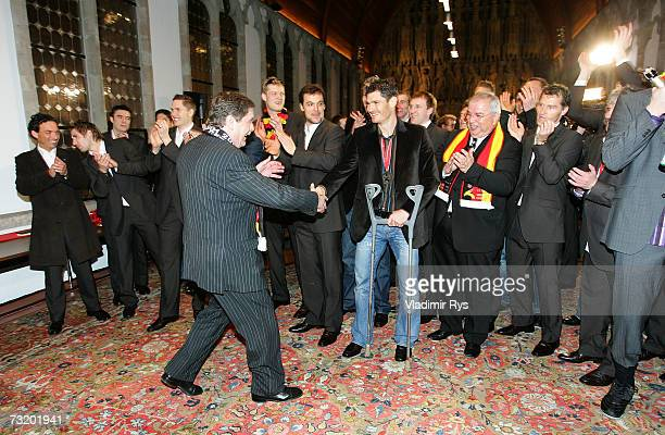 Colognes mayor Fritz Schramma shakes hands with the goalkeeper Henning Fritz as the team arrive for the reception of the Mens German National...