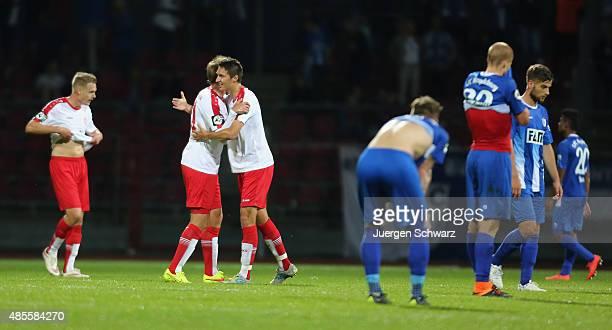 Cologne's Michael Kessel Julius Biada and Markus Pazurek celebrate after the third Bundesliga match between Fortuna Koeln and 1 FC Magdeburg on...