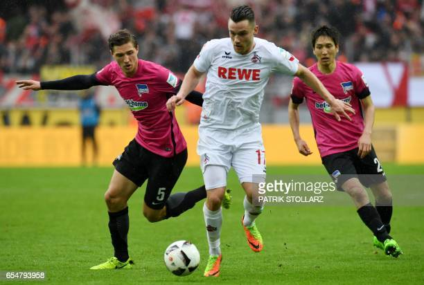 Cologne's midfielder Christian Clemens and Hertha's defender Niklas Stark vie for the ball during the German First division Bundesliga football match...