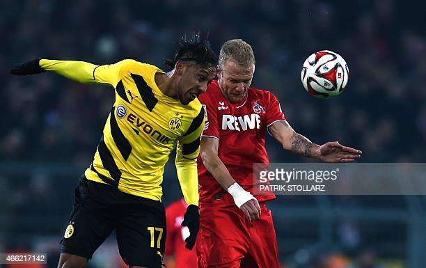 Cologne's midfielder Kevin Vogt and Dortmund's Gabonese striker PierreEmerick Aubameyang vie for the ball during the German first division Bundesliga...