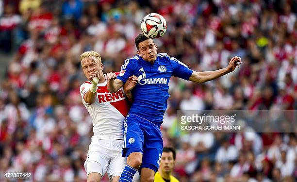 Cologne's midfielder Kevin Vogt vies for the ball with Schalke's midfielder Julian Draxler during the German first division Bundesliga football match...