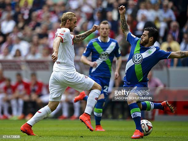 Cologne's midfielder Marcel Risse and Wolfsburg's Vieirinha vie for the ball during German first division Bundesliga football match 1 FC Cologne vs...