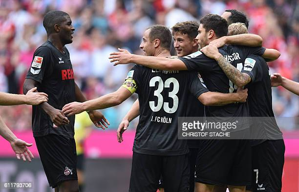 Cologne's players celebrate after the German first division Bundesliga football match between FC Bayern Munich and 1 FC Cologne in Munich southern...