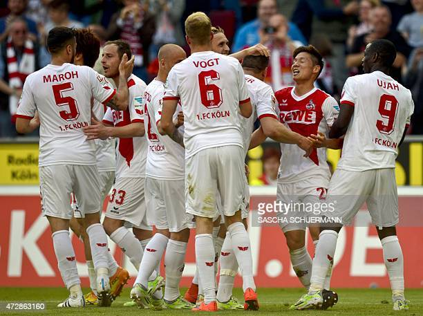 Cologne's players celebrate the 10 goal scored by Cologne's midfielder Marcel Risse during the German first division Bundesliga football match of FC...