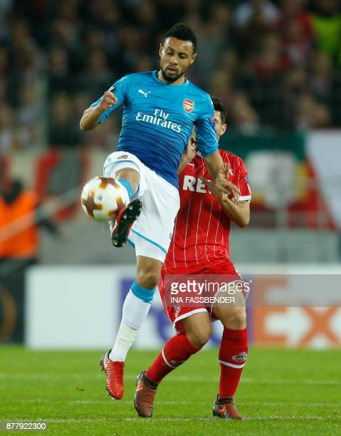 Cologne's Serbian midfielder Milos Jojic and Arsenal's French midfielder Francis Coquelin vie for the ball during the UEFA Europa League football...