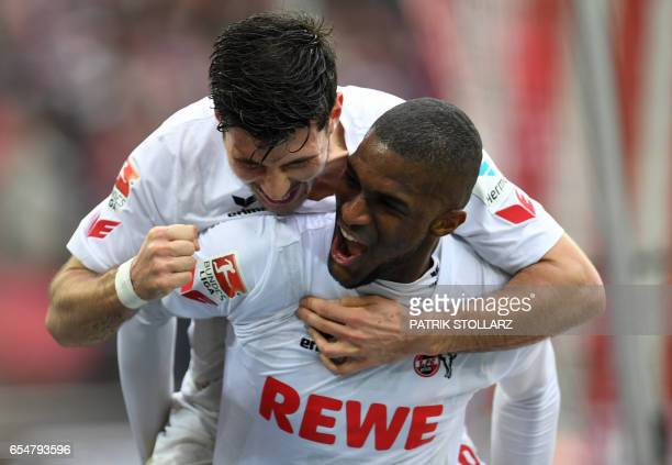 Cologne's Serbian midfielder Milos Jojic and Cologne's French striker Anthony Modeste celebarte after a goal during the German First division...