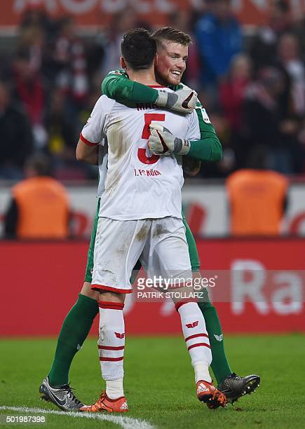 Cologne's Slovenian defender Dominic Maroh and Cologne's goalkeeper Timo Horn celebrate after the German first division Bundesliga football match 1...