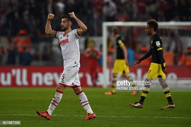 Cologne's Slovenian defender Dominic Maroh celebrates after the German first division Bundesliga football match 1 FC Cologne vs Borussia Dortmund in...
