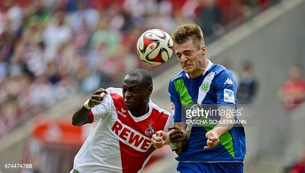 Cologne's striker Anthony Ujah and Wolfsburg's Robin Knoche vie for the ball during German first division Bundesliga football match 1 FC Cologne vs...