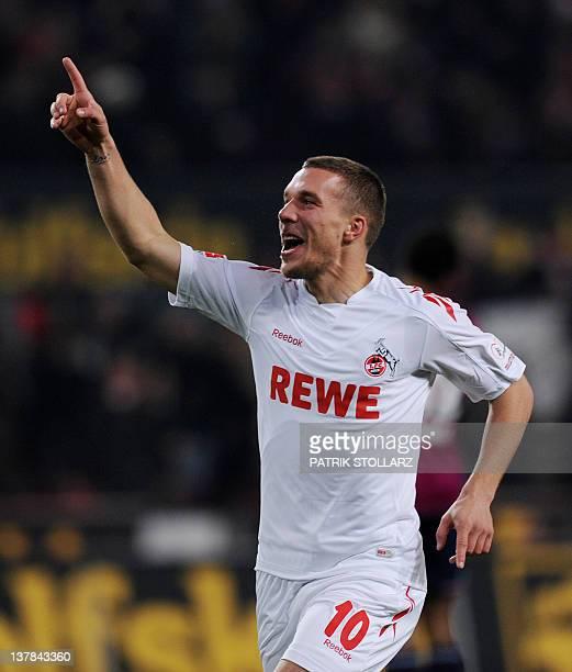 Cologne's striker Lukas Podolski celebrates after scoring during the German first division Bundesliga football match 1FC Cologne vs FC Schalke 04 in...