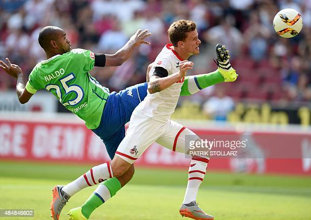 Cologne's striker Simon Zoller and Wolfsburg's Brazilian defender Naldo vie for the ball during the German first division Bundesliga football match...
