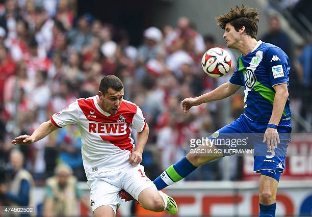Cologne's striker Thomas Broeker and Wolfsburg's Timm Klose vie for the ball during the German first division Bundesliga football match between 1 FC...