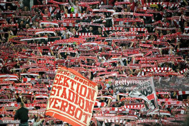 Cologne's supporters cheer their team during the German first division Bundesliga football match Borussia Dortmund v FC Cologne in Dortmund western...