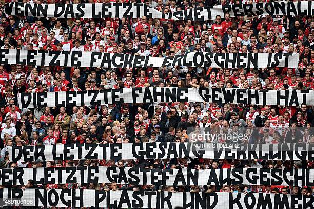 Cologne's supporters display banners during the German first division Bundesliga football match FC Cologne vs Borussia Moenchengladbach in Cologne...