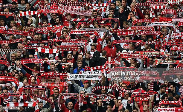 Cologne's supporters display their fan scarves during the German first division Bundesliga football match FC Cologne vs Borussia Moenchengladbach in...