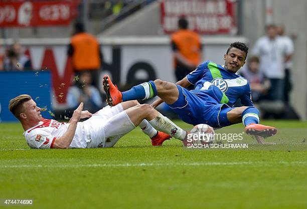Cologne's Yannick Gerhardt and Wolfsburg's Luiz Gustavo vie for the ball during German first division Bundesliga football match 1 FC Cologne vs VfL...
