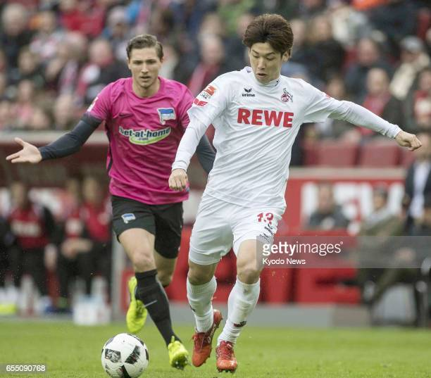 Cologne's Yuya Osako scores the opening goal during the first half of a German Bundeslega game against Hertha Berlin in Cologne Germany on March 18...