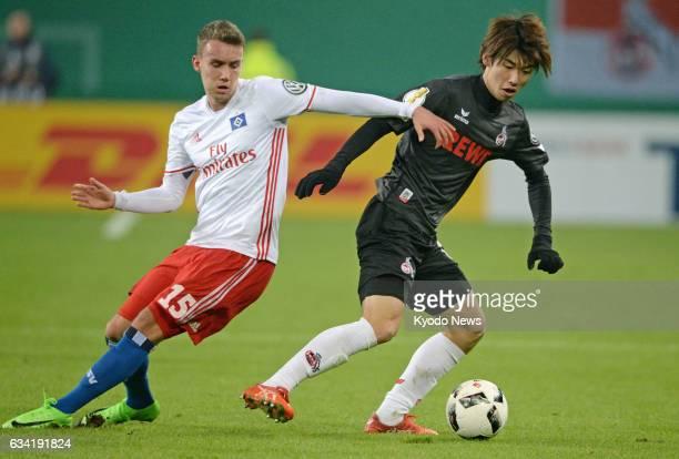 Cologne's Yuya Osako tries to hold Luca Waldschmidt of Hamburger SV off the ball during a German Cup match in Hamburg on Feb 7 2017 Hamburger won 20...