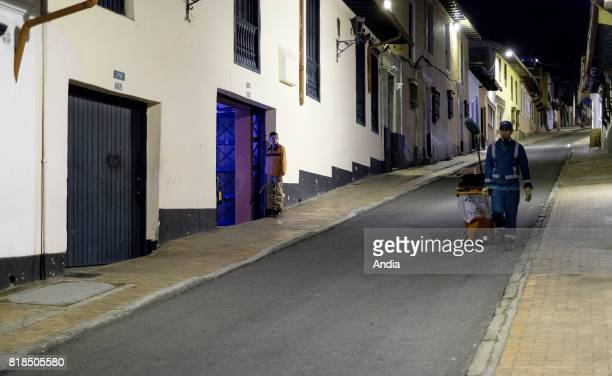 Colombia Bogota Garbage collector passing in the streets of the capital city with his trolley at night