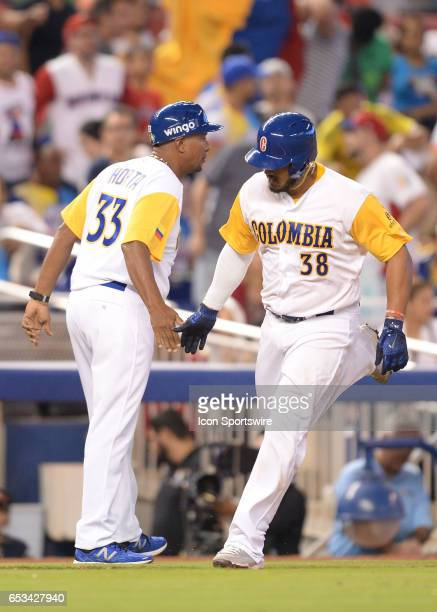 Colombia catcher Jorge Alfaro turn on third base after he homer during the World Baseball Classic 1st Round Pool C game between the Dominican...